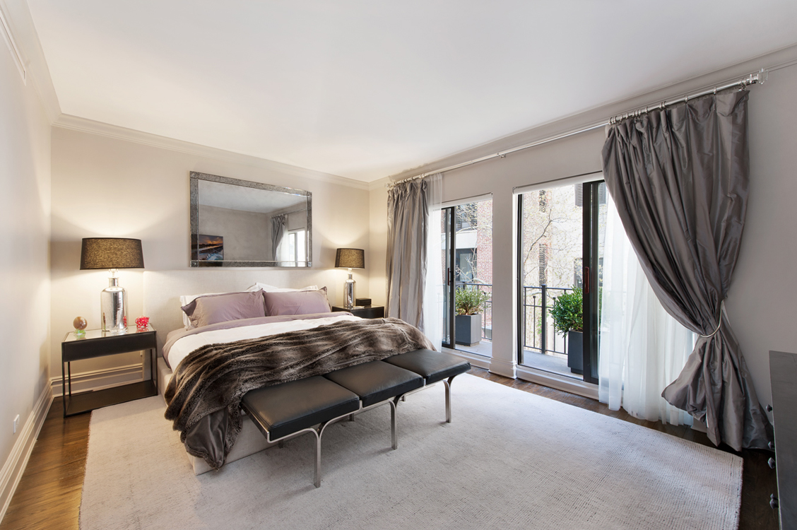 Luxury carpeted bedroom with a balcony